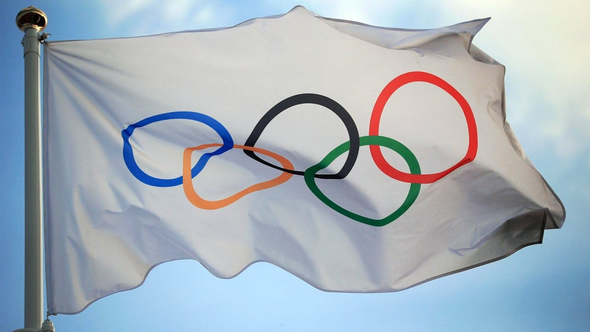 A white flag with the Olmpic rings