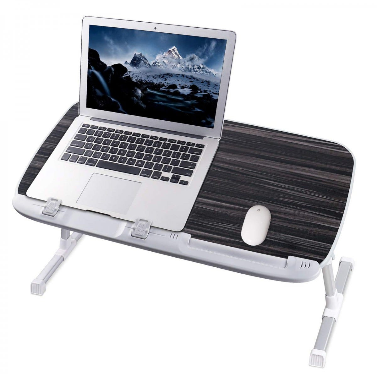The NEARPOW Laptop Desk for Bed with an open laptop and mouse on it.