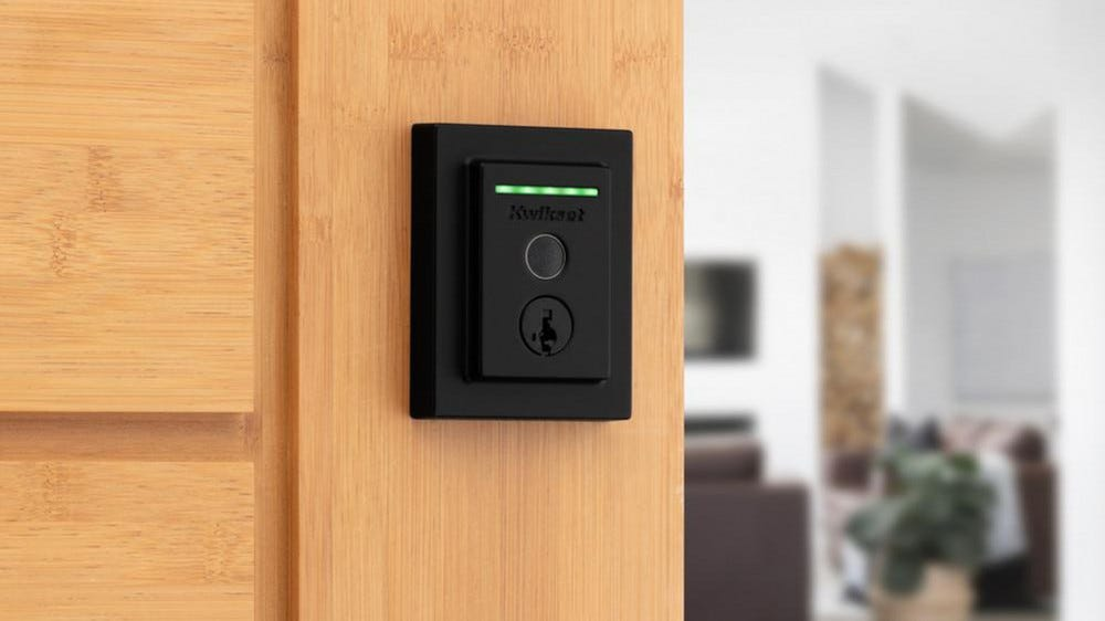 Kwikset Halo Touch mounted on wooden door in a modern house