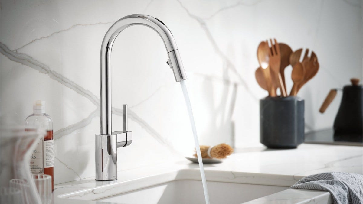 A smart faucet dispensing water into a sink.