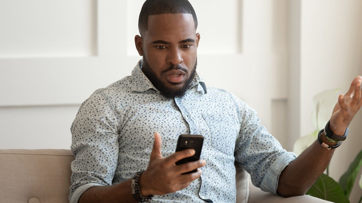 A man is frustrated on the phone with his service provider.