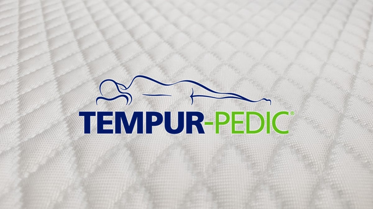 The TEMPUR-Pedic logo on top of the TEMPUR-Adjust's quilted cover.