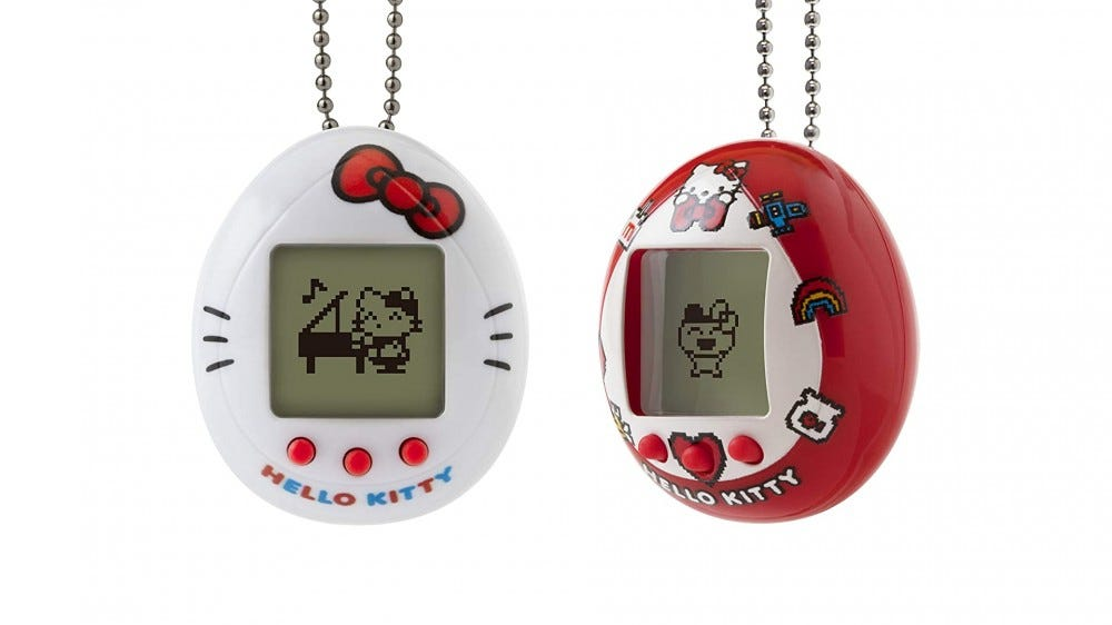 A photo of the new Hello Kitty Tamagotchi in white and red.