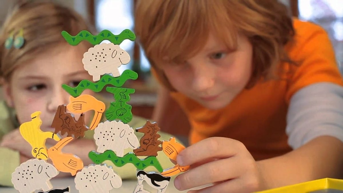 Children playing HABA's Animal Upon Animal game