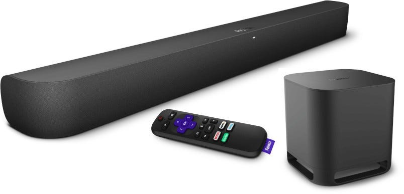 A Roku smart soundbar and subwoofer, next to a Roku controller.