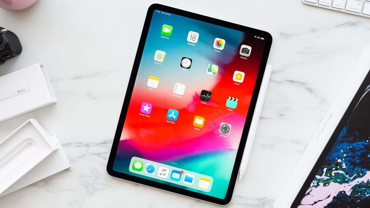 The iPad Pro on a pretty marble countertop.