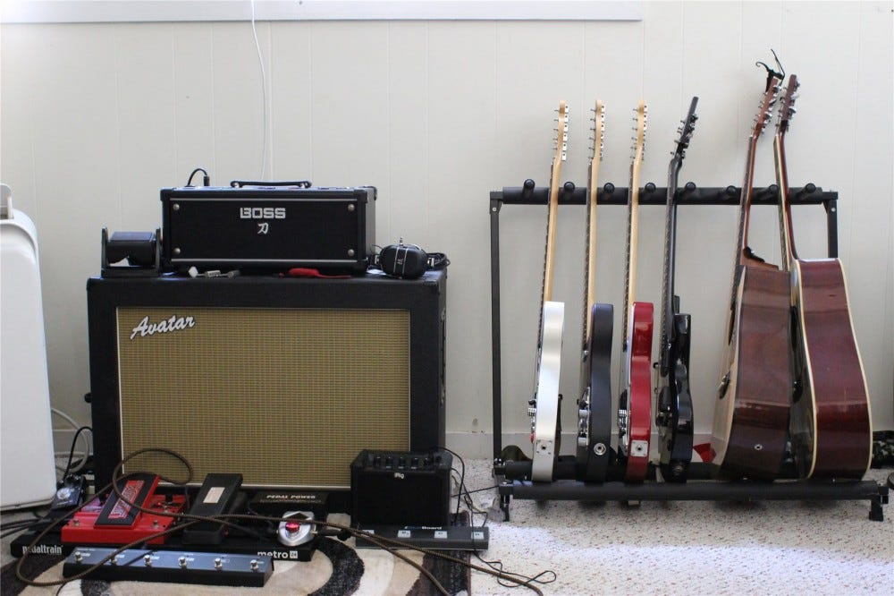 Boss Katana Head, Avatar cab, and 6 guitars
