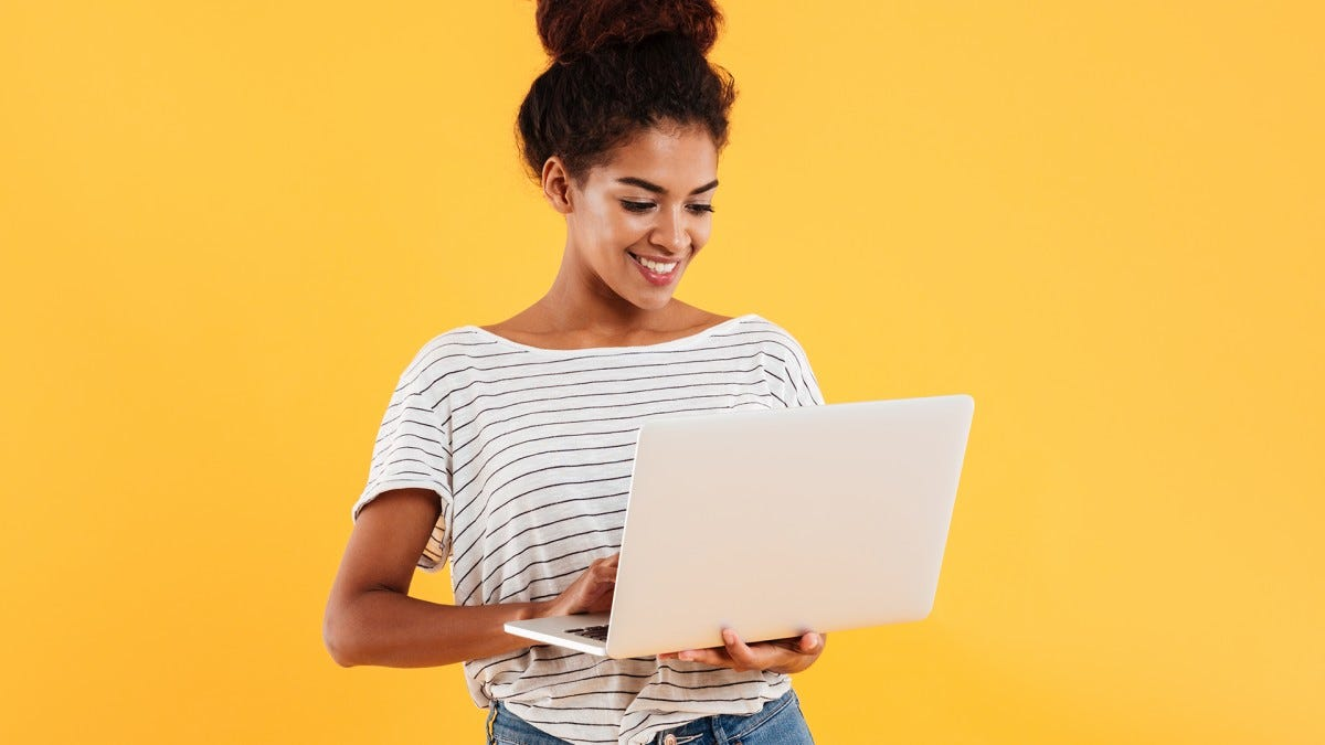 A college student browses the internet on her laptop.