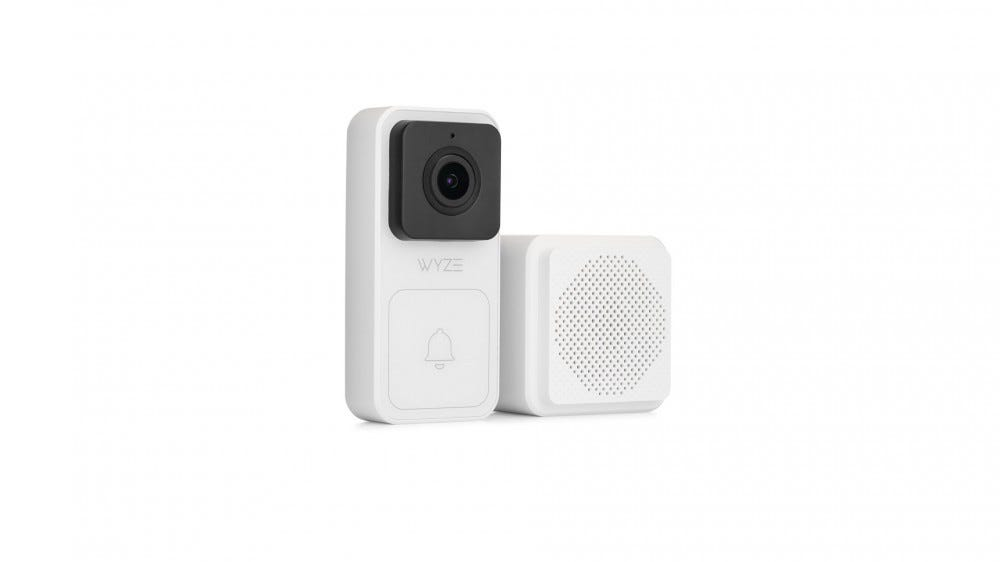 A Wyze video doorbell next to a white bell.