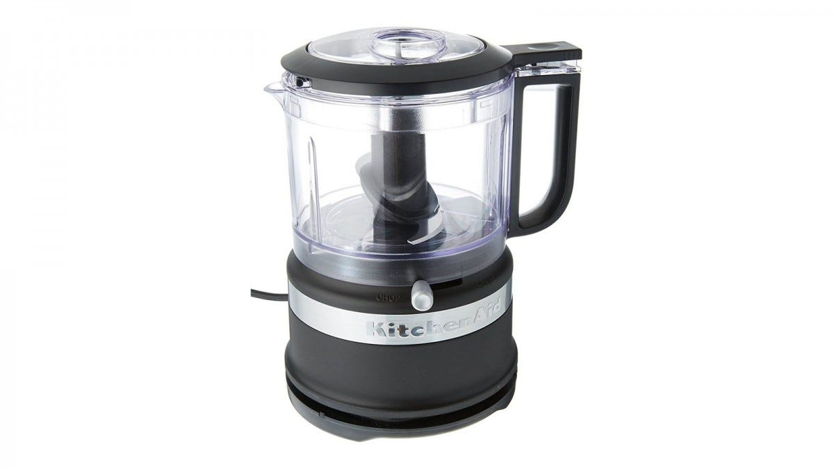 A small black KitchenAid food chopper with pour spot.