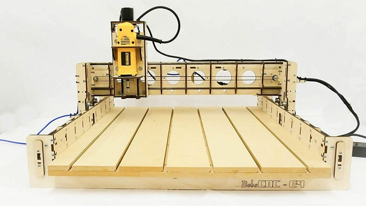 A BobsCNC E4 CNC machine featuring a yellow DeWalt router.