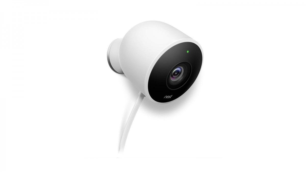 A White Nest Cam Outdoor camera with a power cord hanging from the bottom.