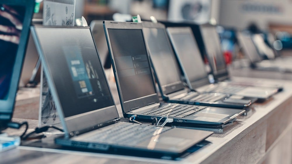 A series of laptops in the data warehouse.