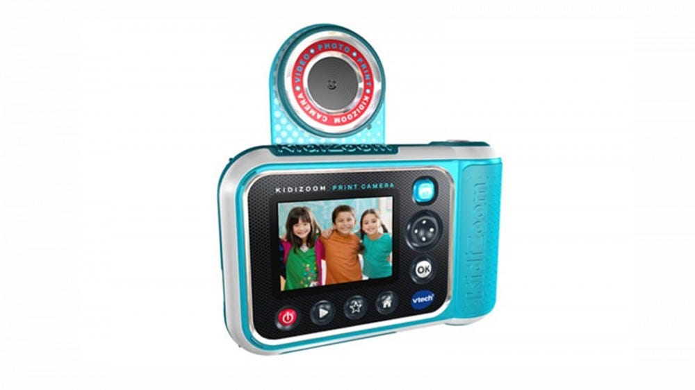 The back of the KidiZoom PrintCam, with its digital screen and flip-up lens.