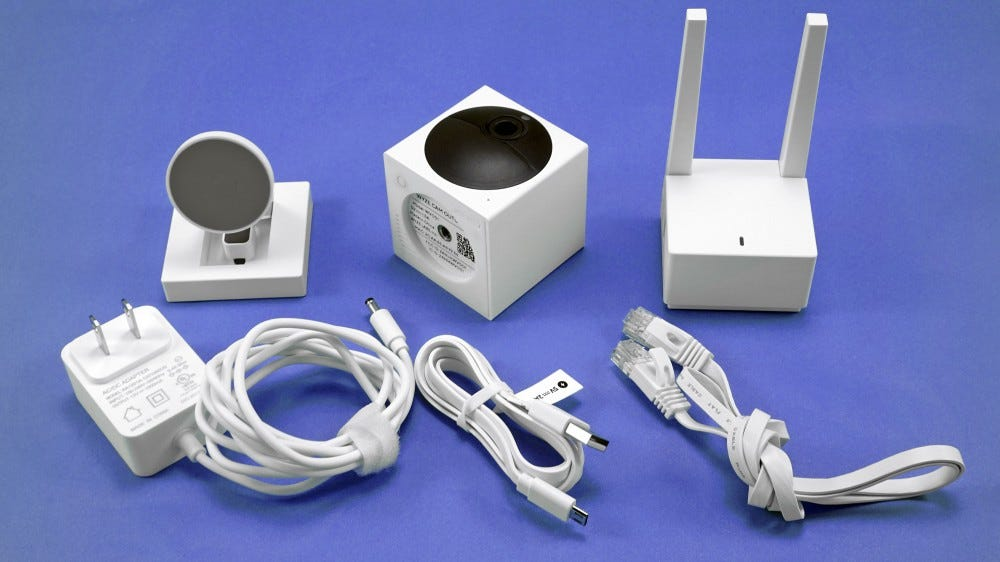 Wyze Cam Outdoor, base station, mount, and power cables