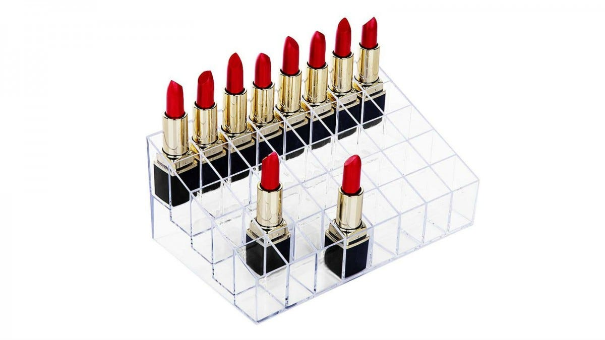 The hblife Lipstick Holder with some tubes of opened red lipsticks.