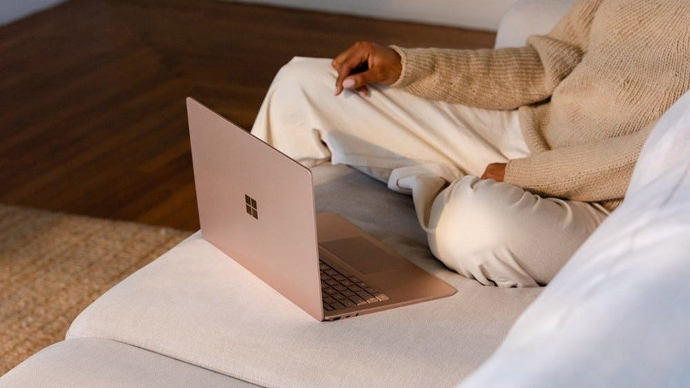 Microsoft surface laptop 3 on a couch