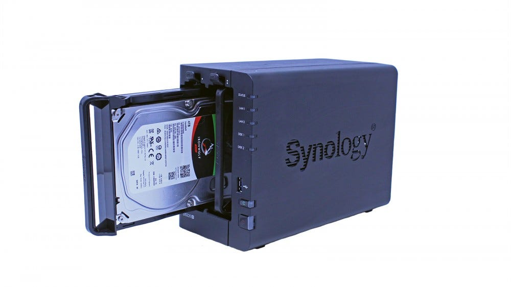 The Synology DS220+ NAS with one drive slid out.