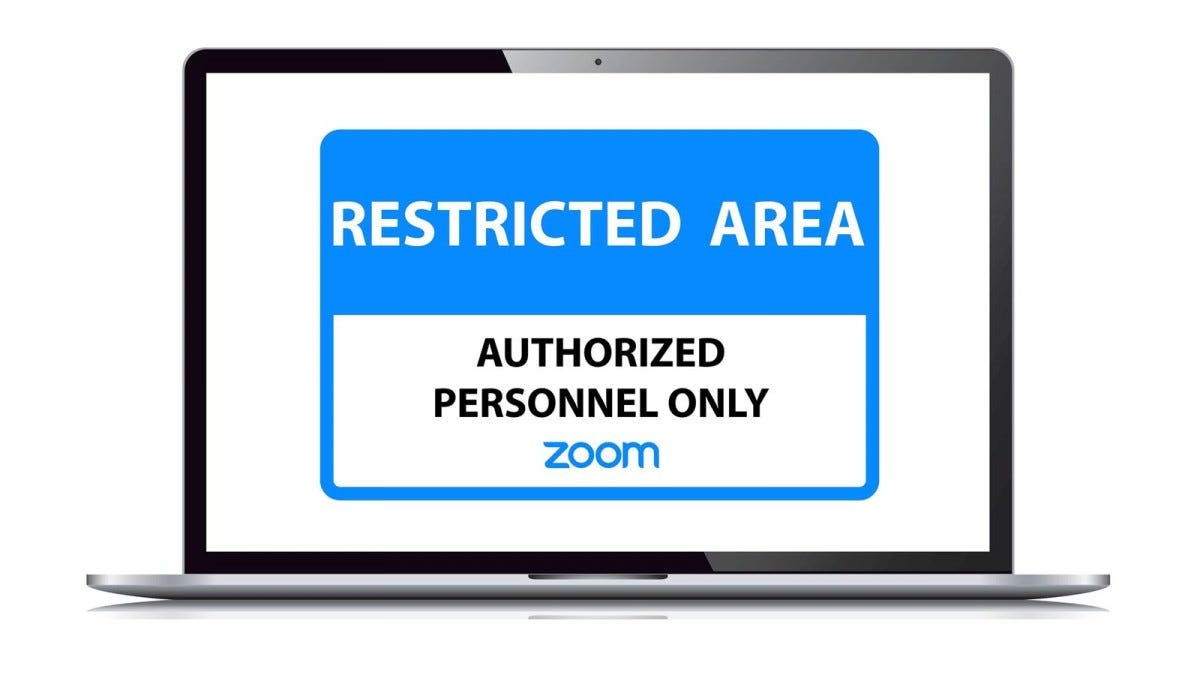 "An ""Authorizex Zoom Personnel Only"" sign on a MacBook"