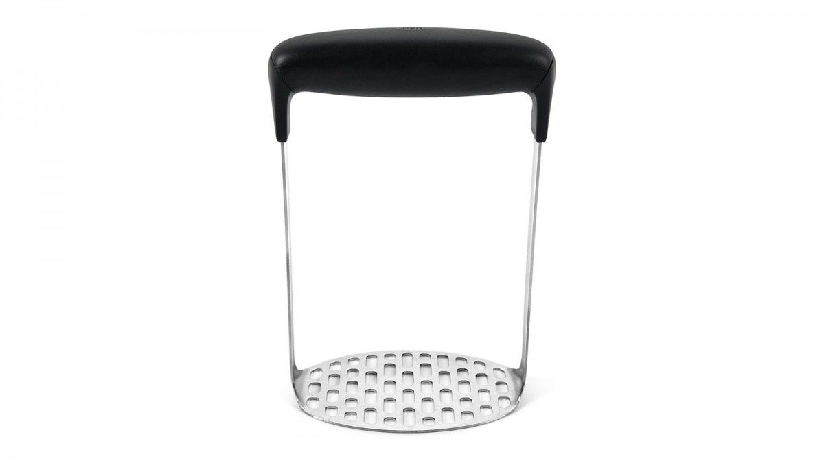 A stainless steel potato masher with large black handle.