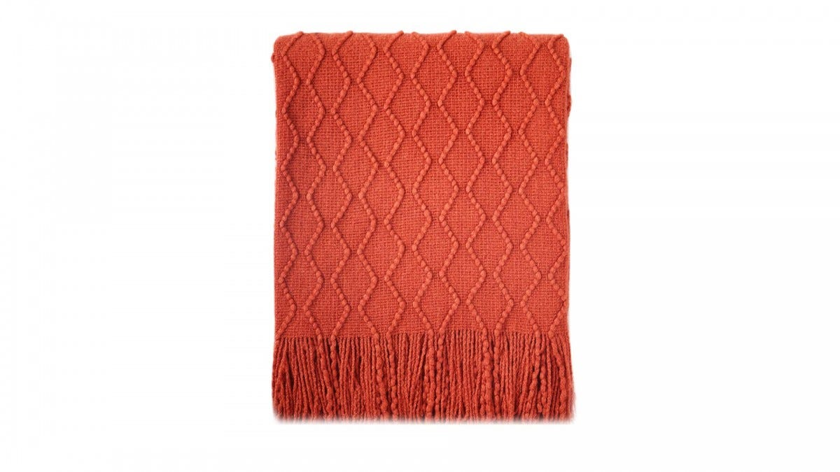 The BOURINA textured throw blanket.