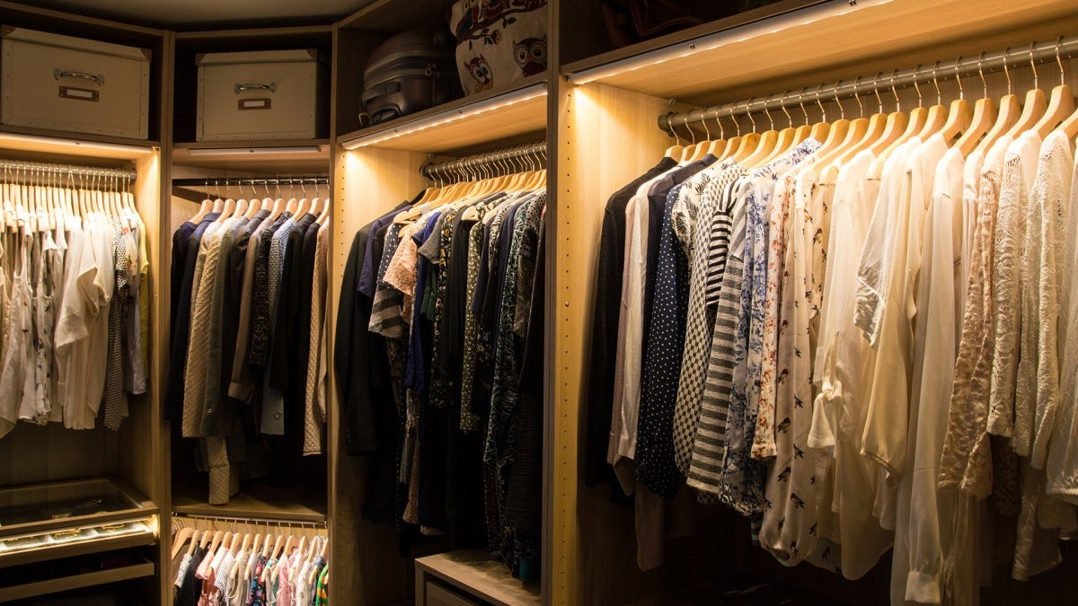 A walk-in closet with motion sensor LED light strips.