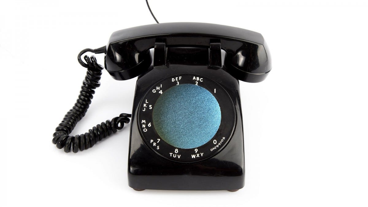 A rotary phone with a Nest Mini for a dialer
