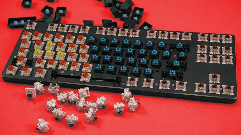The GMMK keyboard with a variety of switches installed.