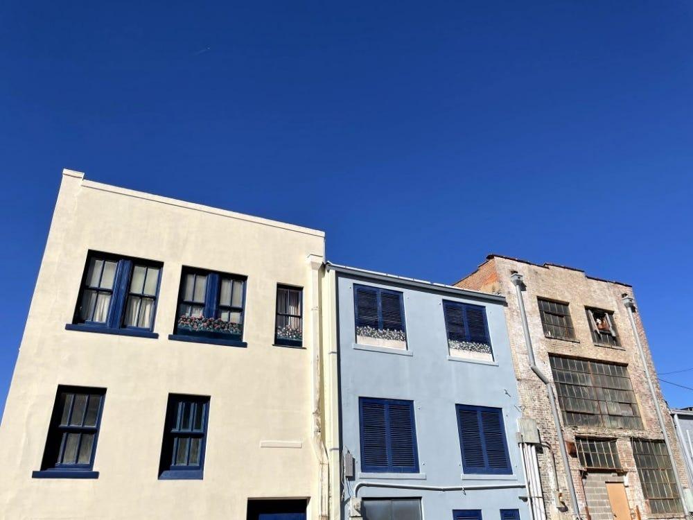 iPhone 12 Mini Sample: Old buildings, painted. Blue sky.
