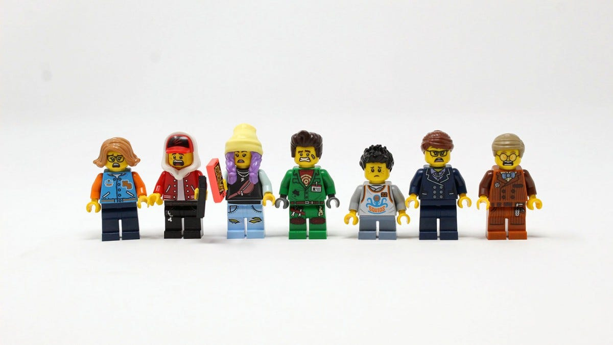 Seven LEGO minifgs, each with a comical expression on their face.