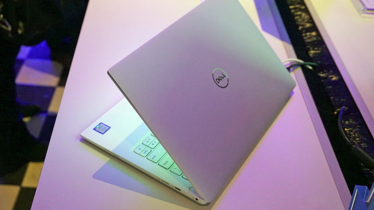 A Dell XPS 13 laptop seen from the back.