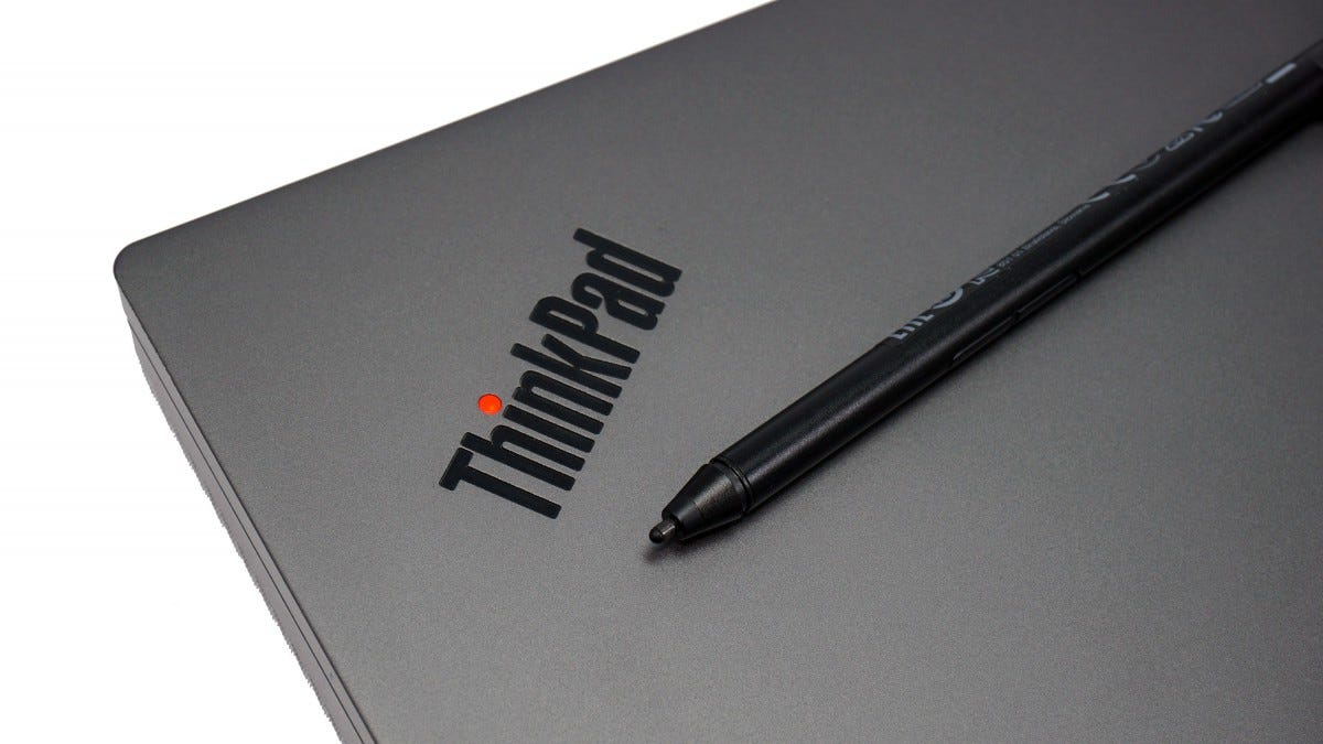 The X1 laptop closed, with it's stylus resting on top of it under the ThinkPad logo.