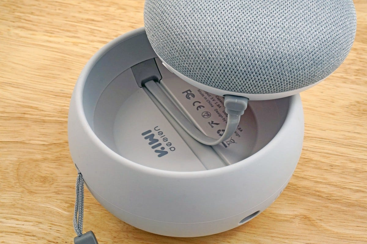 The battery simply plugs into the Home Mini, which then sits in the silicone cup.