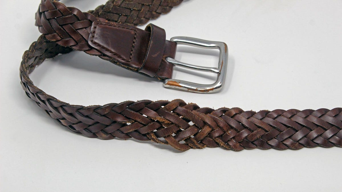 A brown braided belt with one section showing a looser weave.