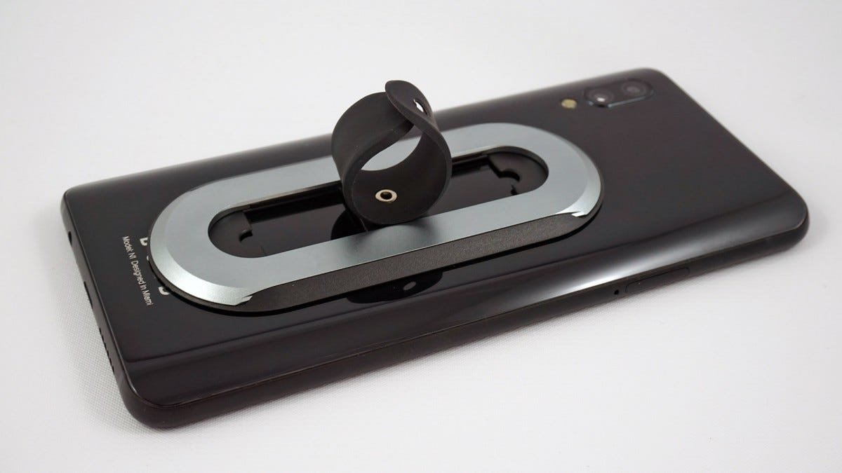 The Ohsnap phone grip, deploying into its ring.