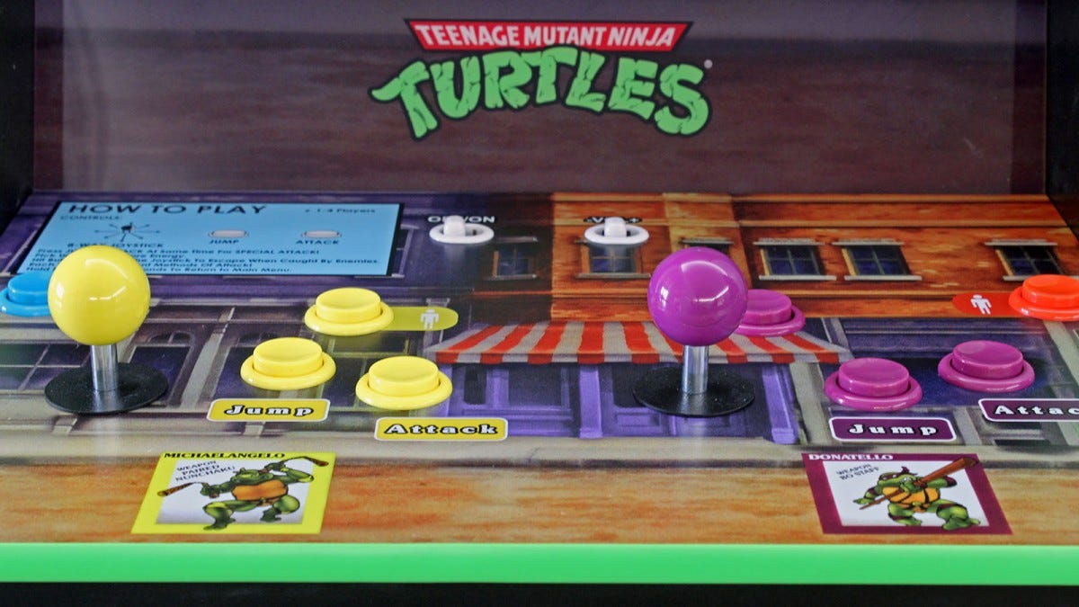 "The ""Teenage Mutant Ninja Turtles"" arcade control deck with two joysticks and six buttons."