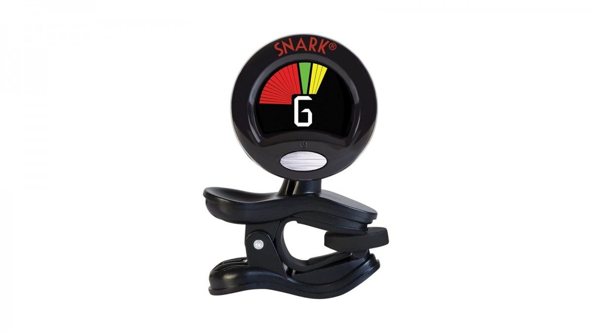 A clip-on tuner displaying a G note along with red, green, and yellow colors.