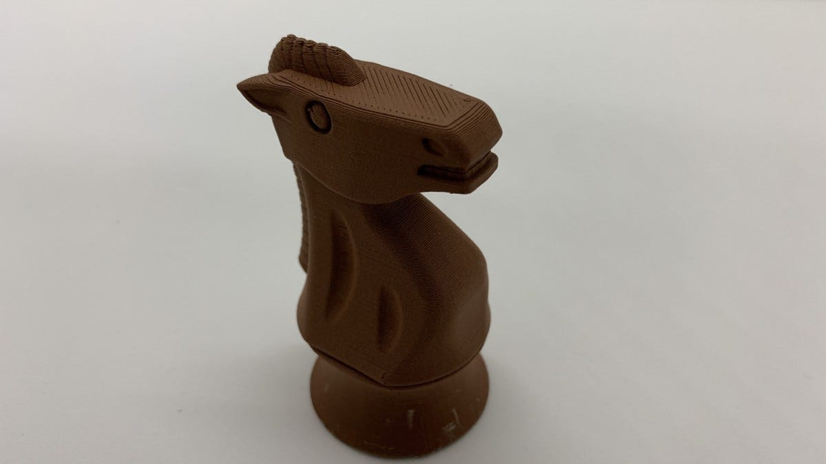a Photo of a chess piece printed with copper filament