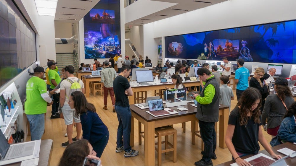 A Microsoft Store in New York with advertisments for 'Sea of Thieves'