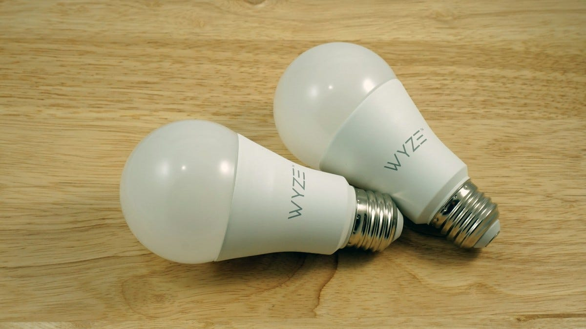 Two Wyze bulbs sitting on a table.