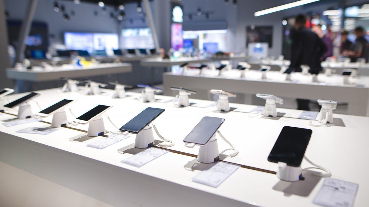 A lineup of new phones at an electronics store.