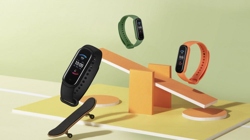 The Amazfit Band 5 in black, green, and orange.