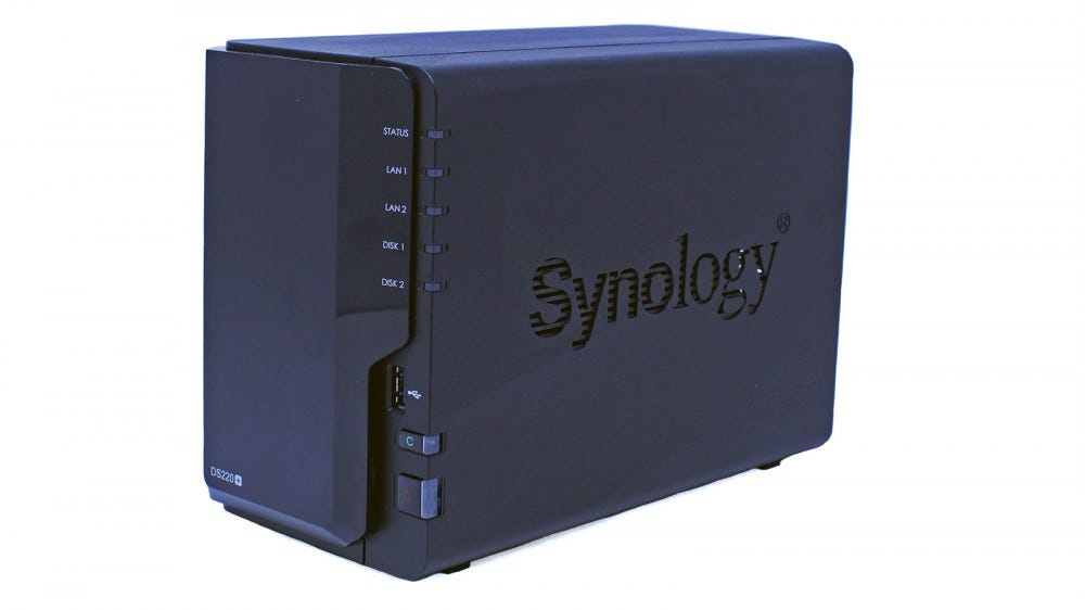 The Synology DS220_ NAS seen from the right, showing the power button and one-touch copy button.