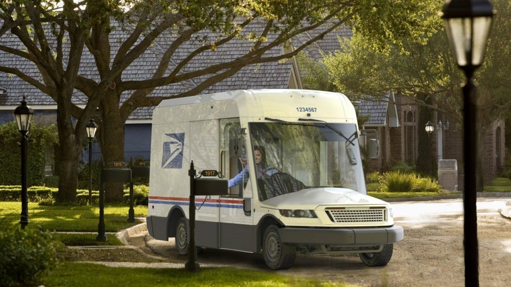 A next-generation mail truck with a massive windshield and a small bonnet.