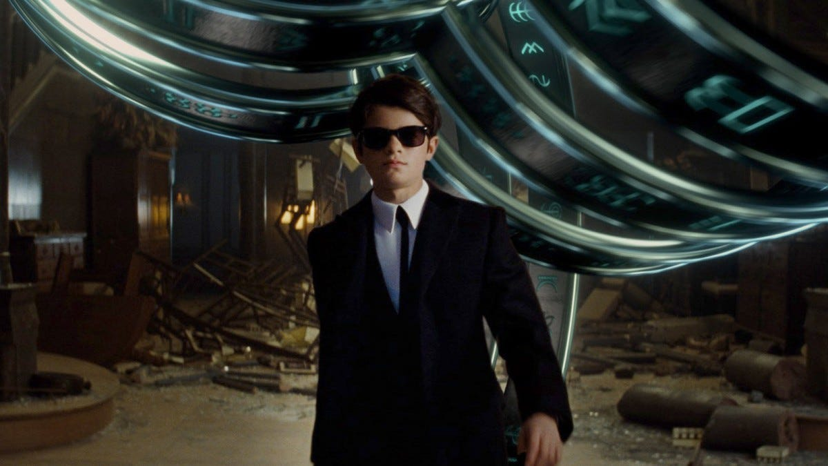 Artemis Fowl wearing sunglasses and walking towards the camera.