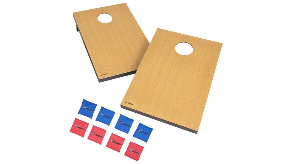 Two plain cornhole boards and eight toss bags