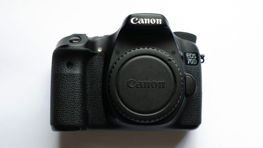 A photo of the Canon EOS 70D, an older DSLR.