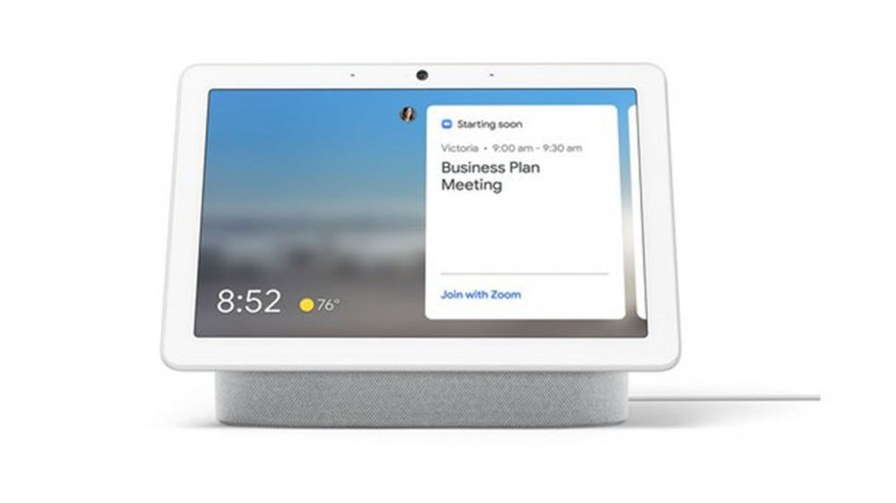 A Google Nest Hub Max with a Zoom calendar appointment displayed.