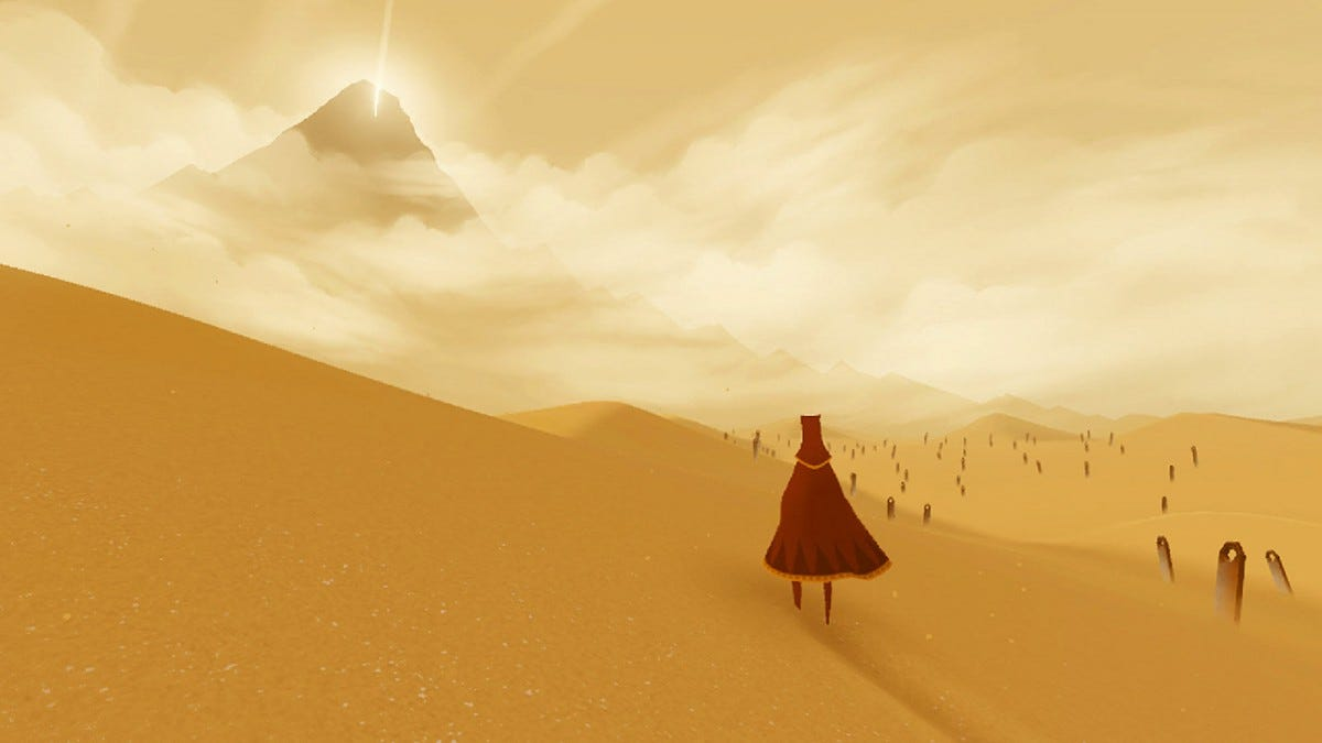 "A screenshot from ""Journey"" showing a desert land and a dune in the distance."