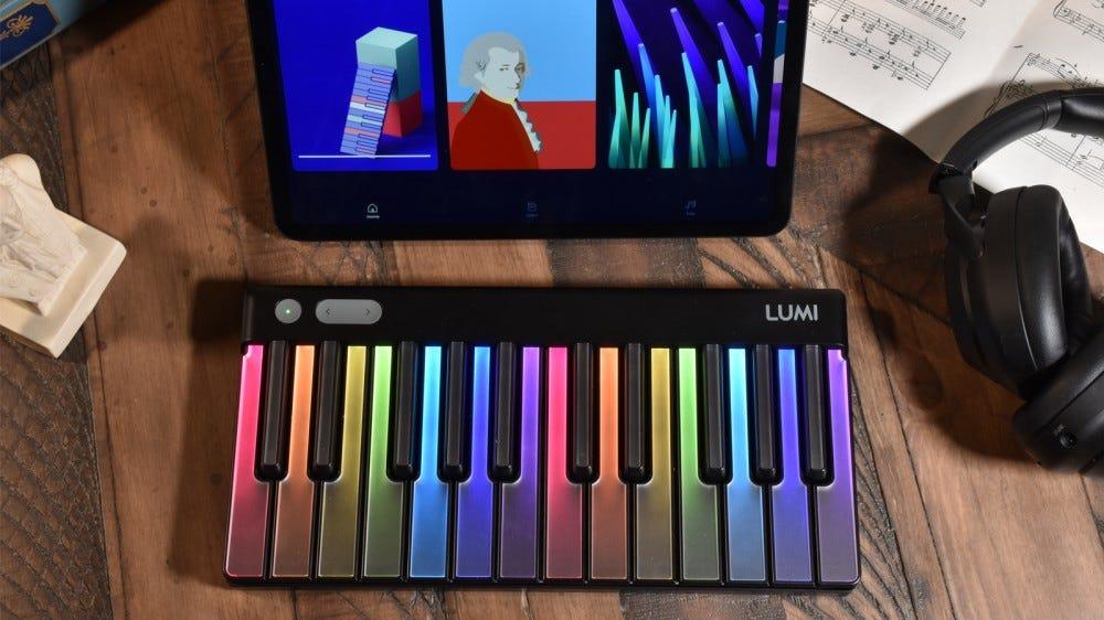 LUMI Keys on table with app on iPad Pro and headphones